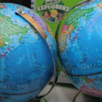two spinning world globe