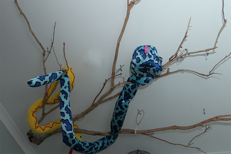 toy snake wrapped on a branch
